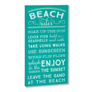 """Decorate your home with this """"Beach Rules"""" wrapped canvas wall art that includes a metal hanger on the back of the frame for easy hanging and measures 10 x 19 x 1."""