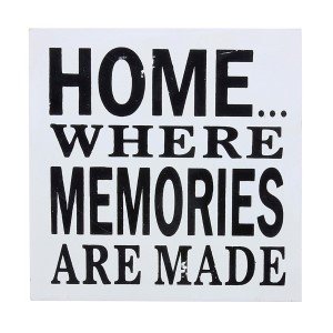 """Distressed wooden decor that reads """"Home... Where memories are made."""" Measures approximately 7"""" x 7""""."""