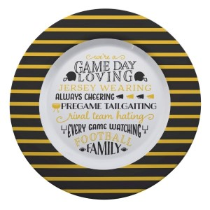 """Gameday melamine plate in black and yellow, that reads """"We're a game day loving, jersey wearing, always cheering, pregame tailgating, rival team hating, every game watching, football family. Measures 14"""" in diameter and is dishwasher safe."""