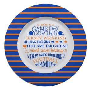 """Gameday melamine plate in royal and orange, that reads """"We're a game day loving, jersey wearing, always cheering, pregame tailgating, rival team hating, every game watching, football family. Measures 14"""" in diameter and is dishwasher safe."""
