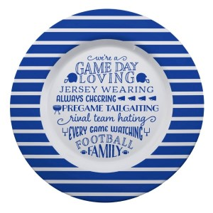 """Gameday melamine plate in royal and white, that reads """"We're a game day loving, jersey wearing, always cheering, pregame tailgating, rival team hating, every game watching, football family. Measures 14"""" in diameter and is dishwasher safe."""