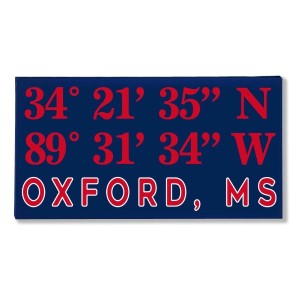 "Canvas wall art with the coordinates of Oxford, MS in your team colors to show your school pride. Canvas measures 10"" x 1.5"" x 19."""