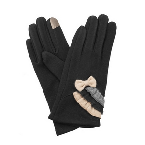 Black, fleece-lined gloves features touchscreen fingertips, and are accented with a bow and ruffles.