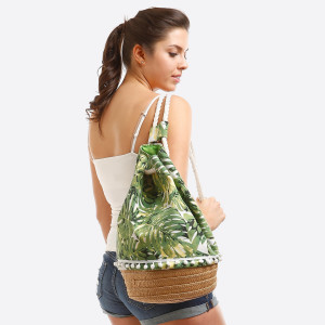 "Fully lined, draw string bag with a tropical print, rope handles that can be worn over one or both shoulders, and an interior pocket. With the round bottom, this bag measures 17"" in height and 11"" in diameter."