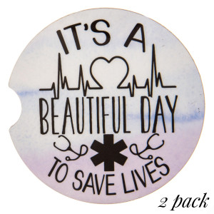 """""""It's a Beautiful day to save lives"""" illustration printed car coaster set.   - Pack Breakdown: 2pcs / pack - Approximately 2"""" in diameter - Finger slot for easy removal - Condensation absorbing cork"""