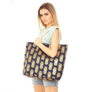 "Navy metallic pineapple canvas beach bag with rope strap details.  - Button closure - One inside open pocket - Approximately 20.5"" W x 16"" T  - Strap length 12"" - 60% Cotton, 40% Polyester"