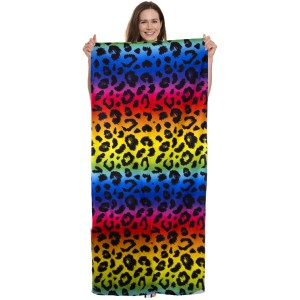 """Rainbow Leopard Print Beach Towel Drawstring Bag All in One.  - Unfold your bag to use the soft beach towel - Conveniently folds back into a drawstring bag - Towel approximately 27"""" W x 59"""" L - 70% Cotton / 30% Polyester"""