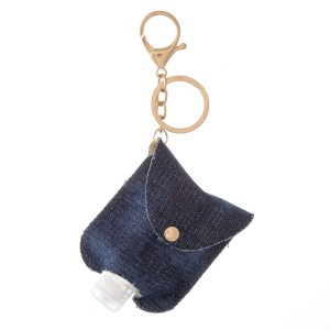 "Keep Your Self Protected While You're Out and About with This Cute Denim Style Tie-Dye Hand Sanitizer Holder.  - Clip to your purse, bag, or diaper bag - Key ring to hold your keys - Fits up to 1fl.oz Sanitizer Bottle - Approximately 3"" T x 2.5"" W"