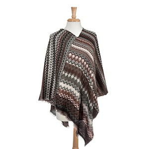 Brown and gray abstract chevron pattern poncho. 100% Acrylic. One size fits most.