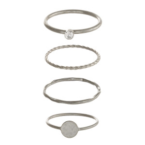 Dainty metal ring set featuring four texturized rings with cubic zirconia details and a silver accent.   - Fits up to a 8 ring size