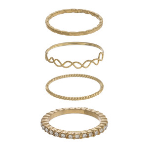 Dainty metal ring set featuring four rings with texturized details and cubic zirconia accents.   - Fits up to a 7.5 ring size