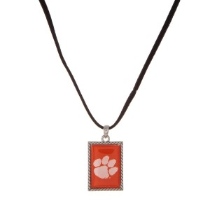 "Officially licensed Clemson University necklace with black cord and a square logo pendant. Approximately 16"" in length."