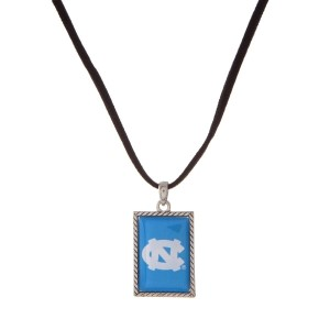 """Officially licensed University of North Carolina necklace with black cord and a square logo pendant. Approximately 16"""" in length."""