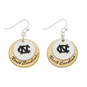"Silver tone officially licensed fishhook earrings featuring two mixed metal disk stamped ""NC"" and ""North Carolina"". Charm approximately 1"" in length. Overall length 1 9/16""."