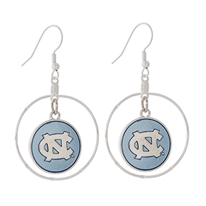 "Silver tone fishhook earrings displaying a ring with a dangling officially licensed blue University of North Carolina charm. Charm approximately 1 1/2"" in length. Overall length 2 1/8""."