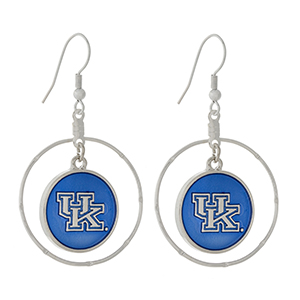 "Silver tone fishhook earrings displaying a ring with a dangling officially licensed blue University of Kentucky charm. Approximately 1 1/2"" in length."
