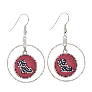 """Silver tone fishhook earrings displaying a ring with a dangling officially licensed red and navy Ole Miss charm. Approximately 1 1/2"""" in length."""