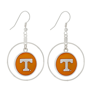 "Silver tone fishhook earrings displaying a ring with a dangling officially licensed orange University of Tennessee charm. Approximately 1 1/2"" in length."