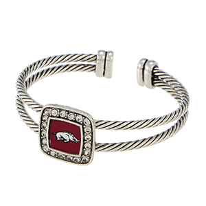 Silver tone officially licensed cuff bracelet featuring the Arkansas logo and clear crystal rhinestones.