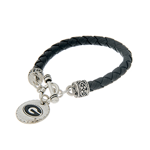 "Black braided faux leather toggle bracelet with an officially licensed silver tone University of Georgia charm. Approximately 7 1/2"" in length."