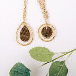 Wholesale metal chain necklace disc pendant raffia woven inspired center details
