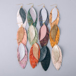 Wholesale double layered feather inspired earrings cork metallic details