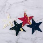 Wholesale metallic cowhide star cut out earrings